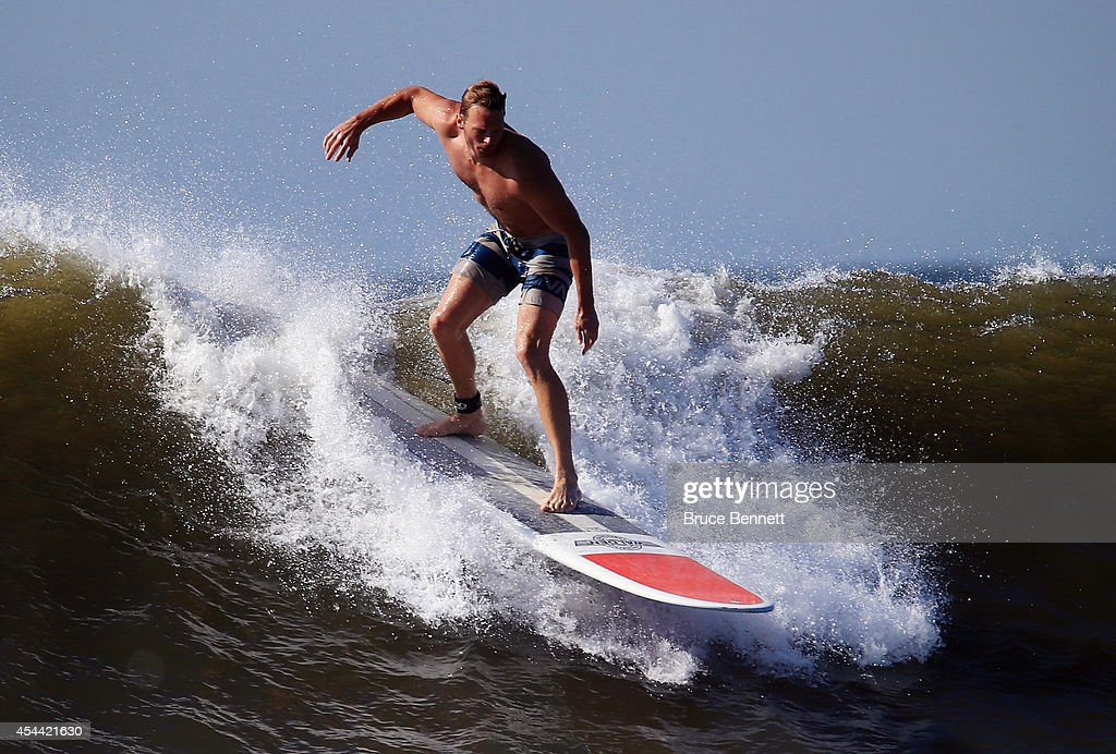 A surfer enjoys four to six foot swells off the Atlantic Ocean on August 28, 2014 in Long Beach, New York. Hurricane Cristobal is churning up larger than normal waves along the eastern coast of the United States.