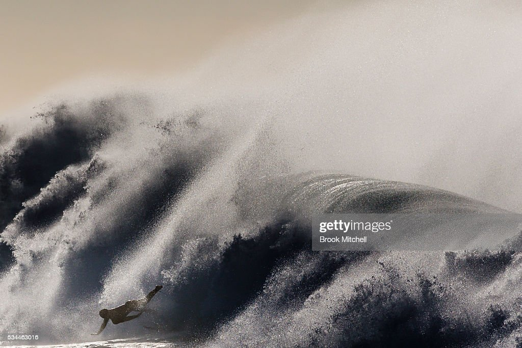 A surfer fall on a large wave at Bronte Beach on May 25, 2016 in Sydney, Australia. All Sydney beaches were closed to swimmers today as large waves pounded the coast.