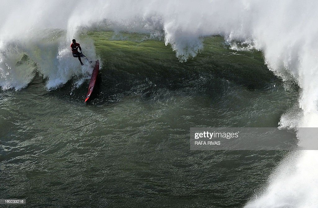 A surfer falls while taking part in the Arnette Punta Galea Big Wave World Tour, on January 28, 2013 in the Northern Spanish Basque town of Getxo. 16 surfers took part during the five hours surf competition, riding 5 meters high waves.