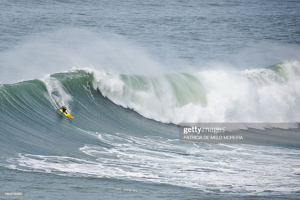 US surfer Garrett McNamara rides a wave during a surf session at Praia do Norte in Nazare on January 30, 2013. McNamara currently holds the world record for the biggest wave surfed after riding a 78-foot (23.77 metre) breaker in Nazare, central Portugal, on November 1, 2011 but on January 28, 2013 was thought to have gone better at the same location. The 45-year-old from Hawaii was cautious about his exploit, though, telling reporters that he had 'no idea' about the size of the wave and that his partner Kealii Mamala may even have set the new global benchmark. AFP PHOTO / PATRICIA DE MELO MOREIRA