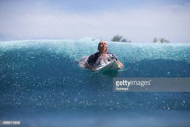 surfer girl comes up for a breath after a duckdive