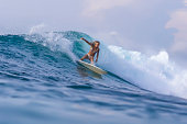 Surfer girl on a wave,Bali,Indonesia