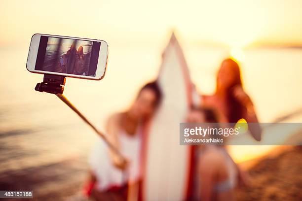 Surfer girls making a selfie