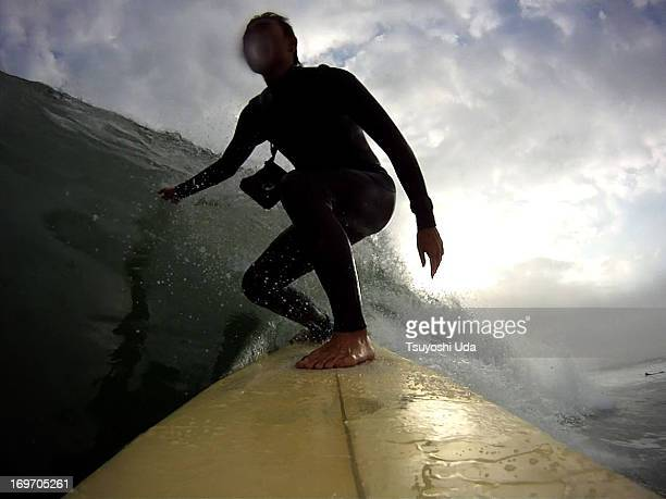 Surfer gliding on the long wall