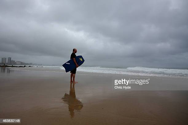 A surfer heads out Snapper Rocks as Cyclone Marcia approaches the coast of Queensland on February 19 2015 in Gold Coast Australia Cyclone Marcia is a...
