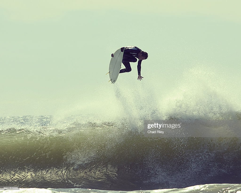 Surfer in mid-air : Stock Photo