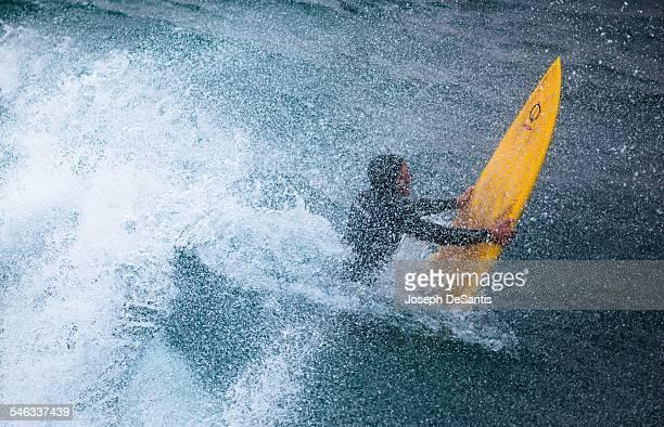 Surfer in the spray of a wave Taken from the Manhattan Beach pier