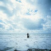 Surfer in water, Half Moon Bay, California