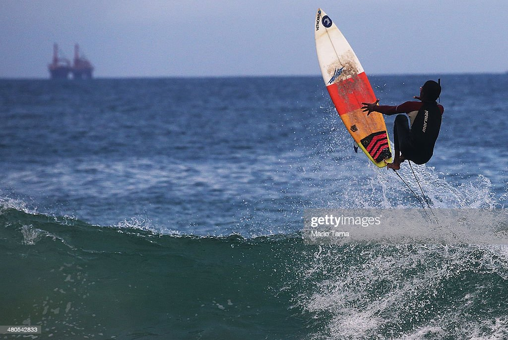 A surfer is tossed from his board near Arpoador Beach on March 25, 2014 in Rio de Janeiro, Brazil. Autumn has arrived in Rio bringing with it much needed rains and increased surf in some areas.