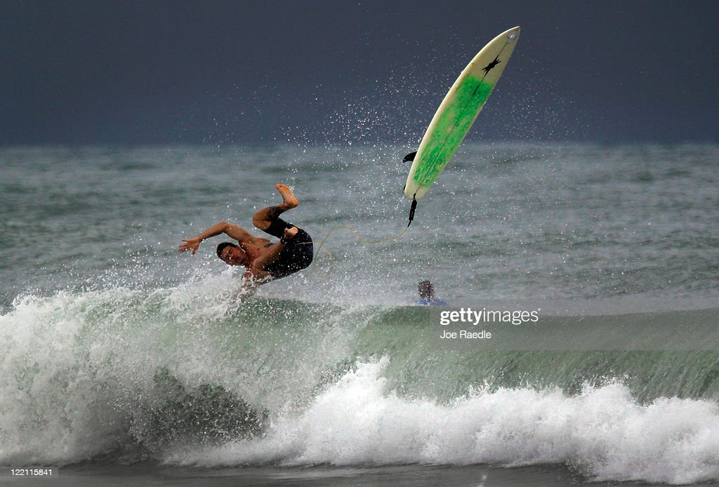 A surfer is upended as he takes advantage of the waves created by Hurricane Irene as it passes off the coast on August 25, 2011 in Fort Lauderdale, Florida. Irene is moving over the Bahamas and could still be a major storm as it approaches the North Carolina coast the morning of August 27.