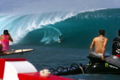 US surfer Keala Kennelly rides a wave at Teahupoo in Tahiti on May 14 2013 Top surfers in the world gathered in Teahupoo since the beginning of the...