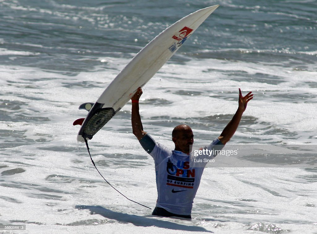 Surfer Kelly Slater celebrates after besting Yadin Nicol to take the US Open of Surfing at Huntington Beach on Sunday Aug 7 2011