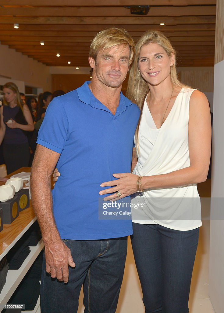 Surfer Laird Haimilton and athlete <a gi-track='captionPersonalityLinkClicked' href=/galleries/search?phrase=Gabrielle+Reece&family=editorial&specificpeople=224806 ng-click='$event.stopPropagation()'>Gabrielle Reece</a> attends the opening of the Velvet by Graham & Spencer store on June 6, 2013 in Brentwood, California.