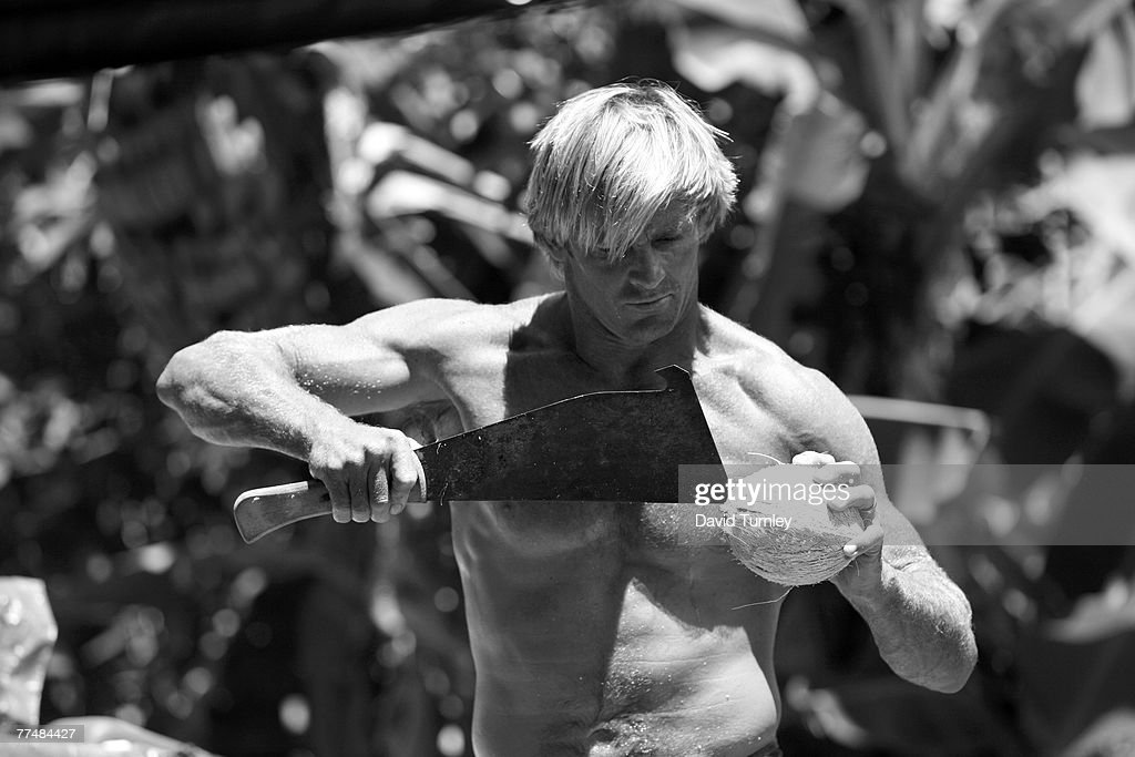 Surfer Laird Hamilton cuts down coconuts on his property in Hawaii.