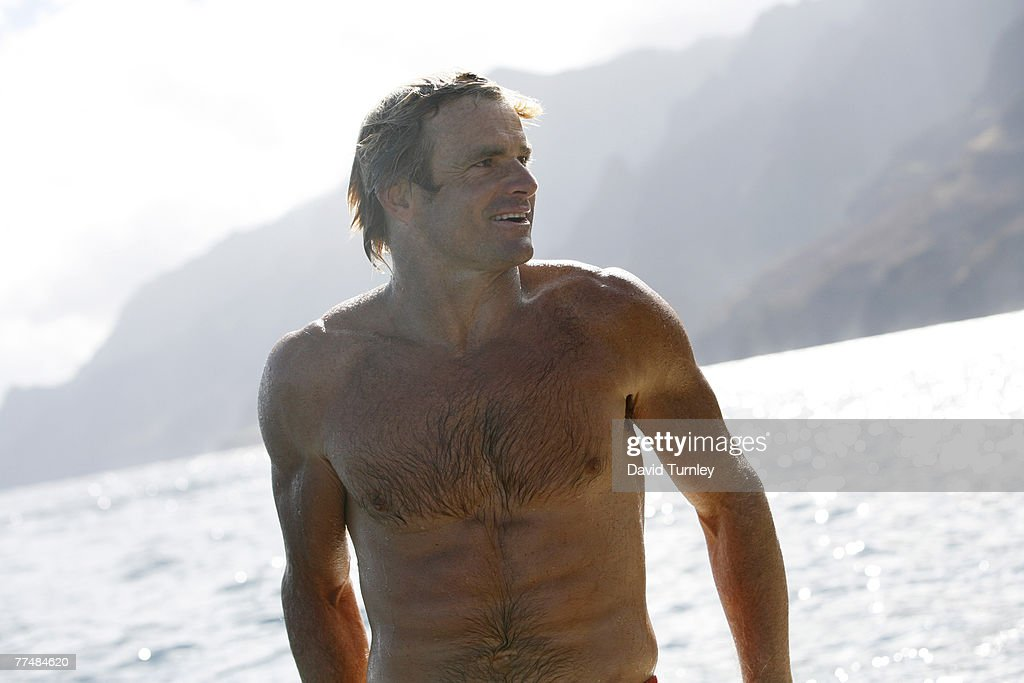 Surfer Laird Hamilton heads up the Nepali coastline in Hawaii.