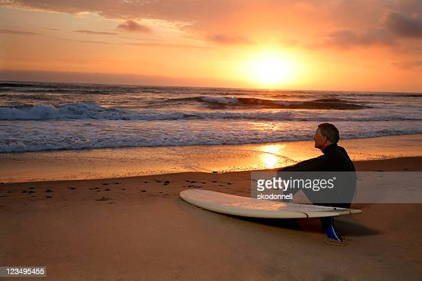 Surfer Looking Off into the Sunset