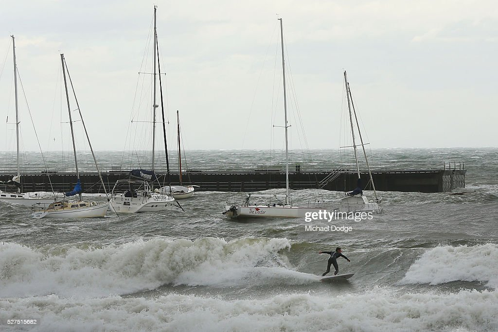 A surfer makes the most of rare waves at Shire Hall beach near Mornington Harbour on May 3, 2016 in Melbourne, Australia. Wind gusts of up to 100km per hour are expected in Melbourne and parts of southern Victoria as part of a deep cold front moves across the state.