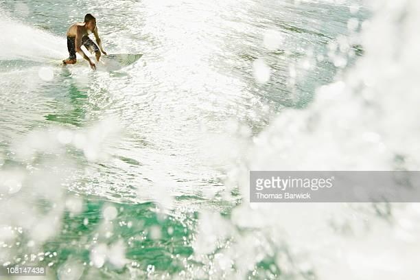 Surfer making a bottom turn on wave