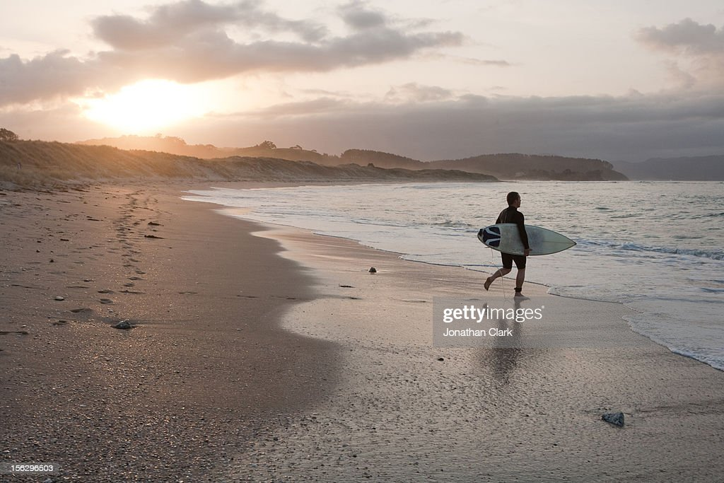 Surfer on beach : Stock Photo