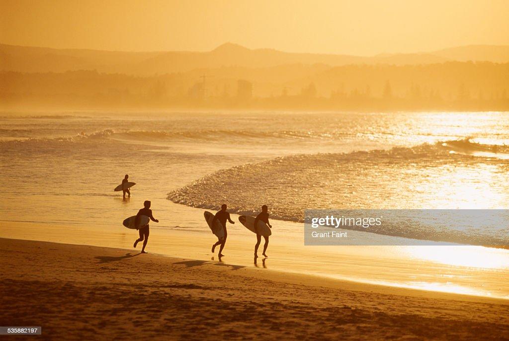 Surfer on beach.