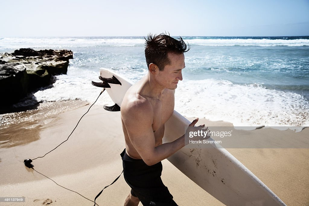 Surfer on the beach : Stock Photo
