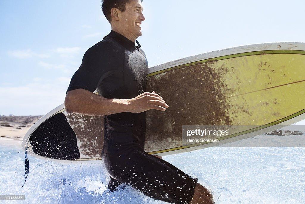 Surfer on the beach : Stock Photo