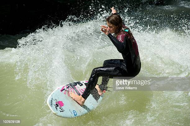 A surfer on the Eisbach a man made river using the Isar River as it's source of water which flows through the Englischer Garten on July 14 2010 in...