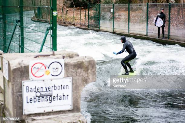 A surfer on the Eisbach in the English garden on December 12th 2017 in Munich Germany The coldest air of the season could be feeling in Munich during...