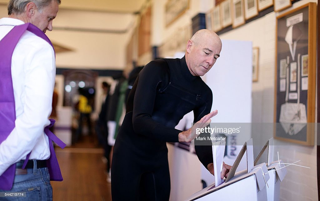A surfer places a ballot paper in a ballot box at Bondi Surf Bathers' Life Saving Club in the electorate of Wentworth on July 2, 2016 in Sydney, Australia. Voters head to the polls today to elect the 45th parliament of Australia.