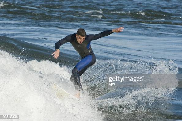 A surfer practices his passion on the St Lawrence River on September 1 2009 in Montreal Canada Forget Hawaii Bali and Hossegor the new popular...