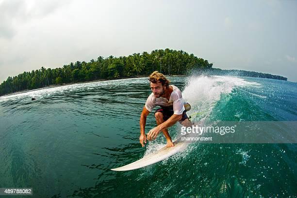 Surfer Races Along A Perfect Wave