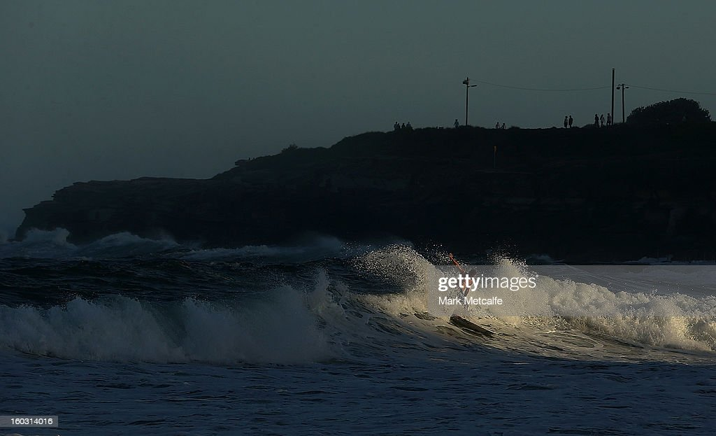 A surfer rides a wave at Coogee Beach after winds and rain battered Sydney last night generating large swell January 29, 2013 in Sydney, Australia. Parts of Sydney are experienced record rainfall after ex-cyclone Oswald swept through the city last night.