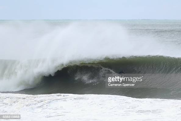 A surfer rides a wave at North Narrabeen as large swell hits the Australian East Coast on June 6 2016 in Sydney Australia Torrential rain over the...