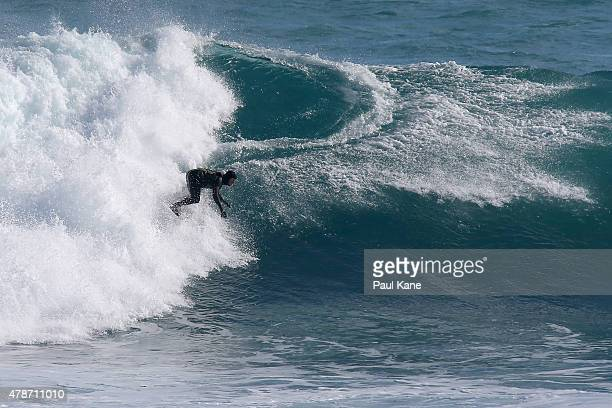 A surfer rides a wave at Surfers Point on June 27 2015 in Margaret River Australia Monster swells were predicted for the south west coast across...