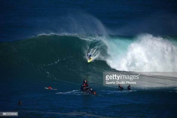 A surfer rides a wave at the Eddie Aikau Big Wave Invitational at Waimea Bay North Shore Hawaii on December 8 2009 in Oahu Hawaii