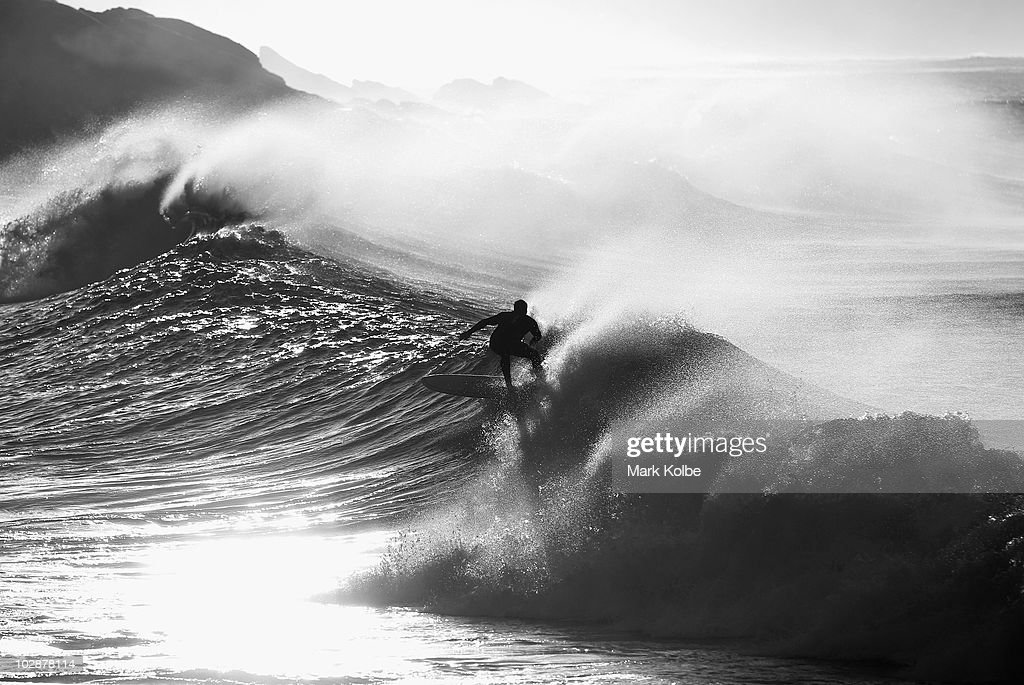 A surfer rides a wave during an early morning session on June 11, 2010 in Victoria Bay, South Africa.