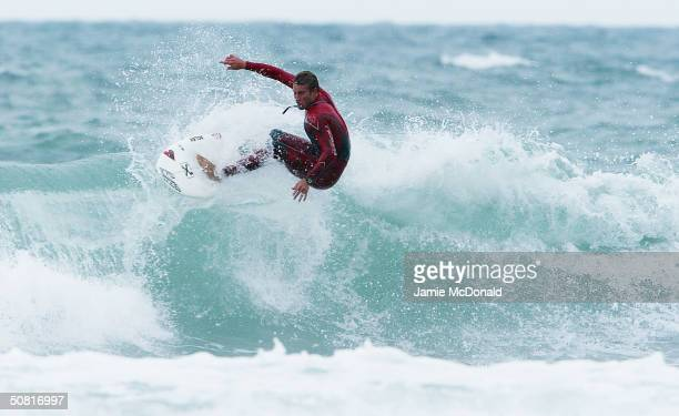 Surfer rides a wave during the Laureus Beach Festival at the Guincho Beach on May 9 2004 in Estoril Portugal