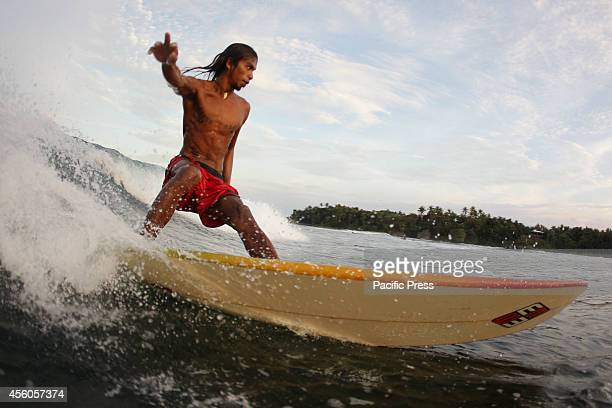 A surfer rides a wave in Cloud 9 Siargao a day before the Siargao Cloud 9 Surfing Cup on September 24 2014 This year's Siargao Cloud 9 Surfing Cup...
