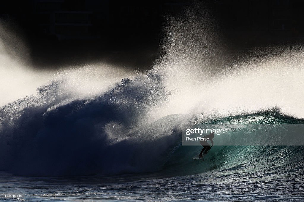 A surfer rides a wave while surfing at Bronte Beach on May 8, 2012 in Sydney, Australia.