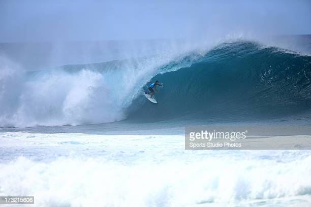 A surfer rides in the tube at 'Pipeline' on the Northshore circa 2012 in Oahu Hawaii
