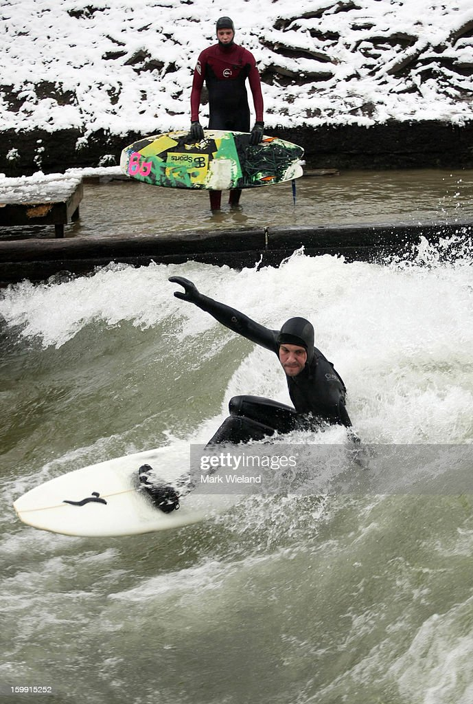 A surfer rides the Eisbach wave in the English Garden on January 13, 2013 in Munich, Germany. The man-made wave at the Eisbach (Ice Brook), which has been surfed since 1972, officially became legal to ride in 2010, but it is recommended that only experienced surfers tackle the wave due to its forceful currents and the concealed concrete riverbed. In the winter, the water temperature can plummet to -1 degree celcius.