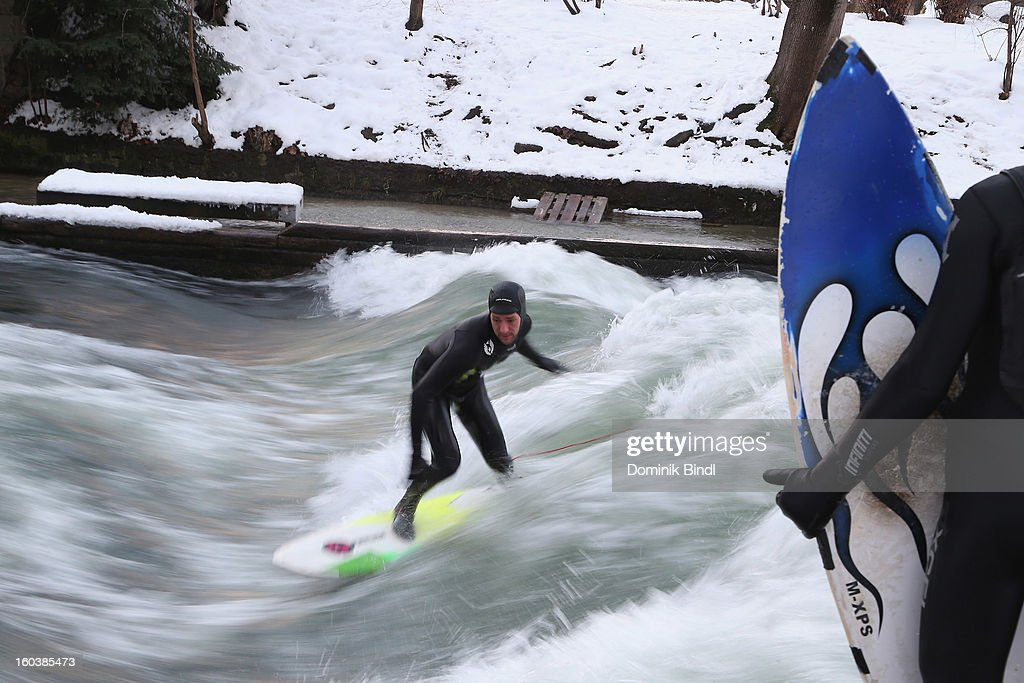 A surfer rides the Eisbach wave on January 23, 2013 in Munich, Germany.
