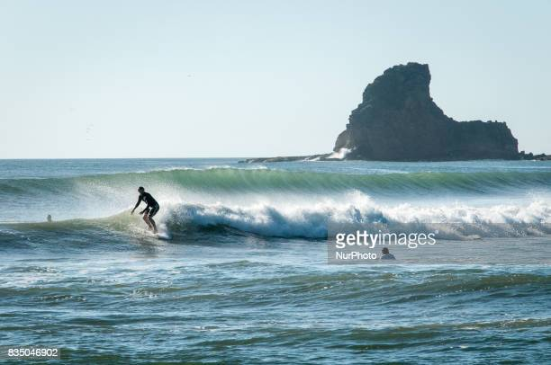 A surfer rides the waves of the Pacific Ocean near San Juan del Sur Nicaragua a popular surfing destination on 7 November 2011