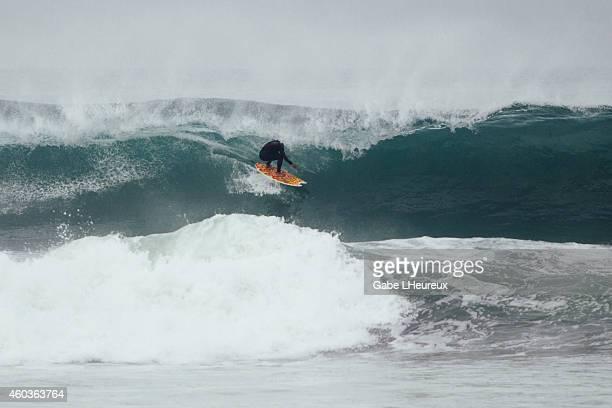 A surfer rides through a hollow tube on December 11 2014 in San Diego California