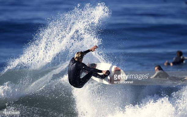 A surfer riding a wave in the ocean