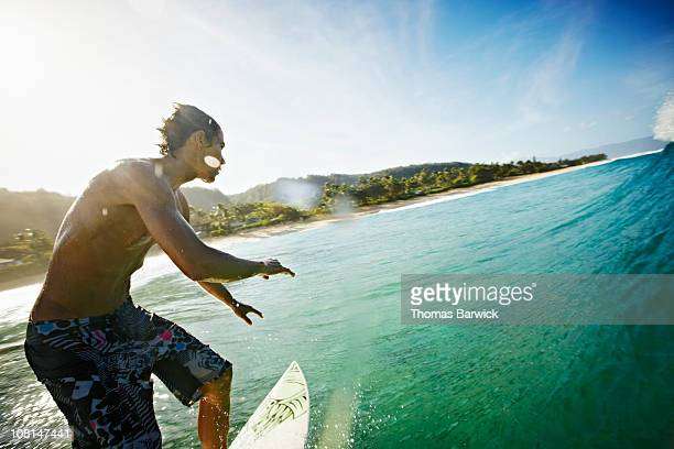 Surfer riding along face of wave view from water