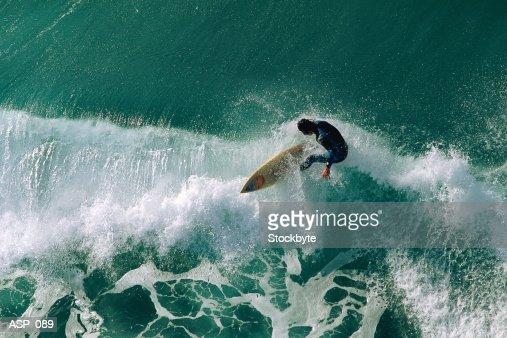 Surfer riding wave : Photo