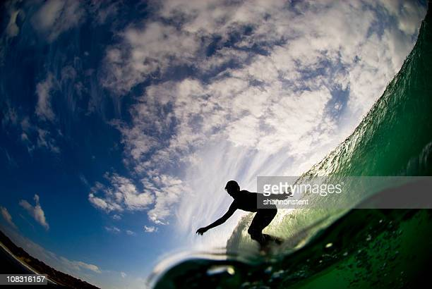 Surfer Silhouetted On Wave