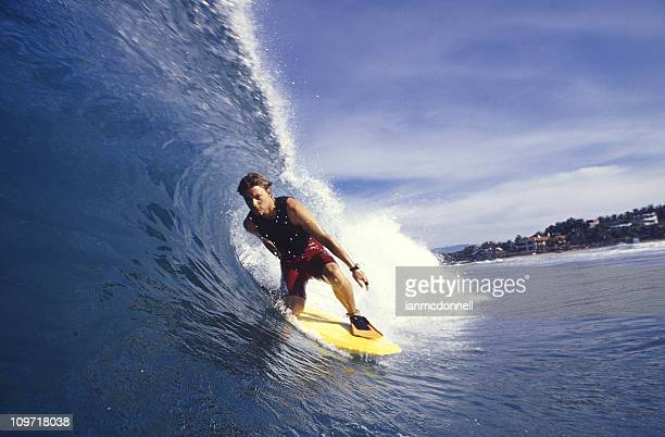 A surfer surfing in the sea in a high wave loving it