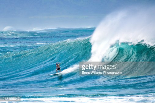 Surfer surfing in waves